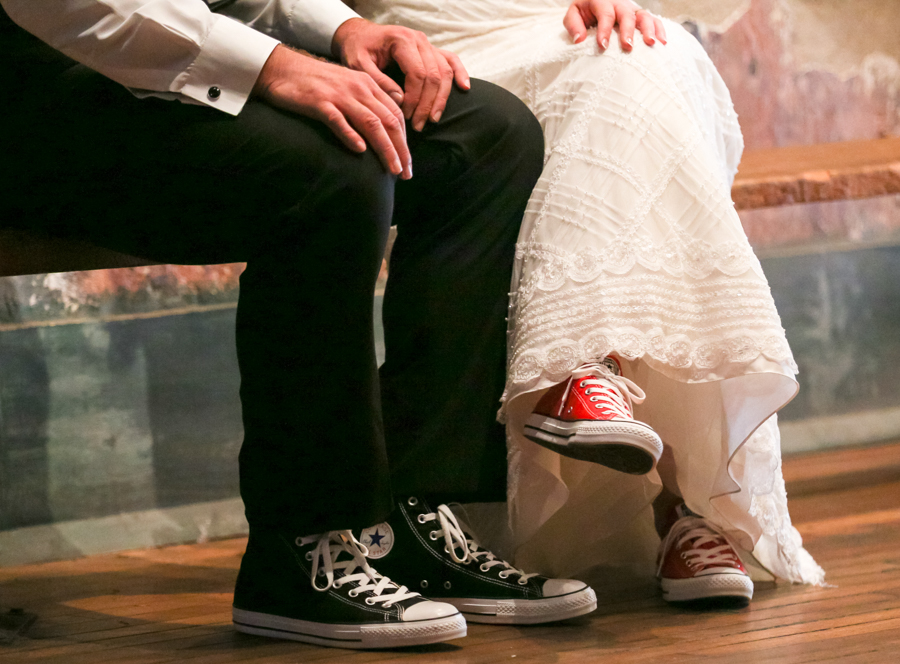 Close up of the bride and grooms Chuck Taylor Allstar shoes