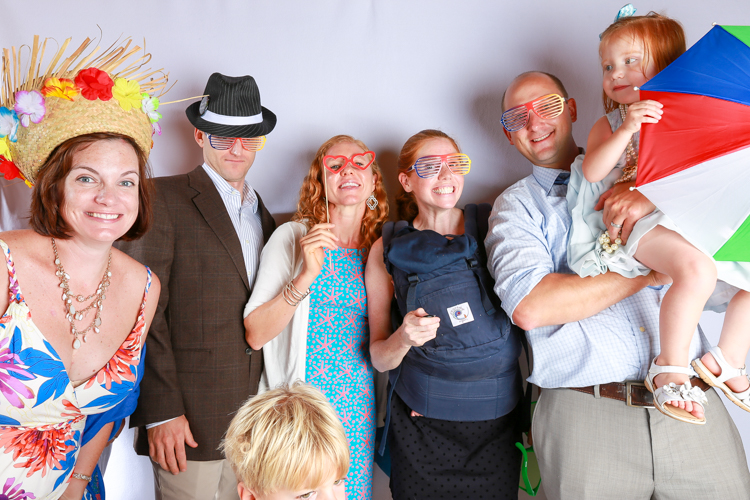 Large group and Photo Booth striking various poses funny stuff on