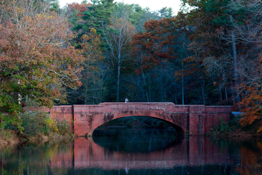 View of the bridge crossing the bass pond on Biltmore Estate in Asheville, NC