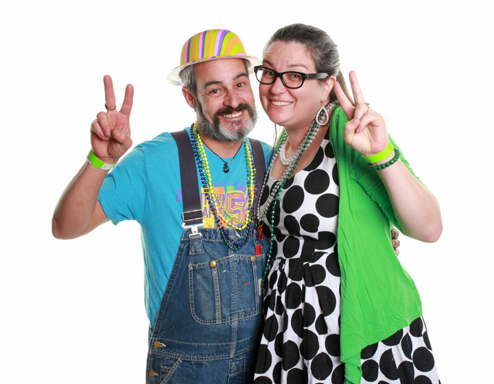 Two people in the Open air photo booth rented by Down Town Asheville thank you party!