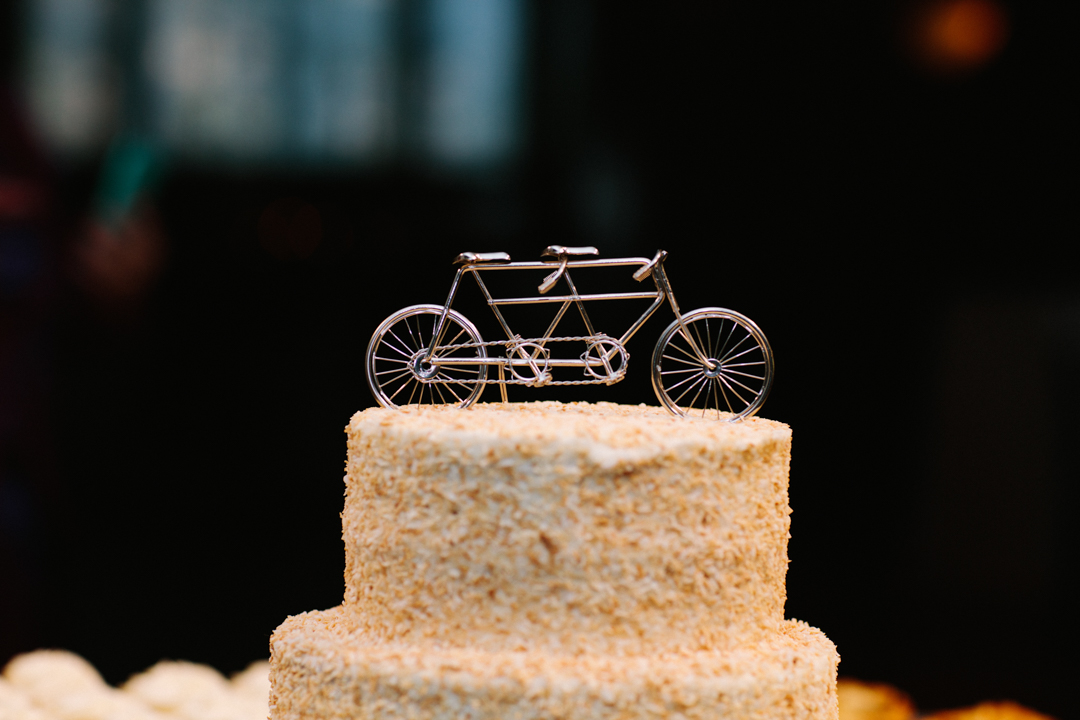 Close up of cake topper which is a bicycle built for 2