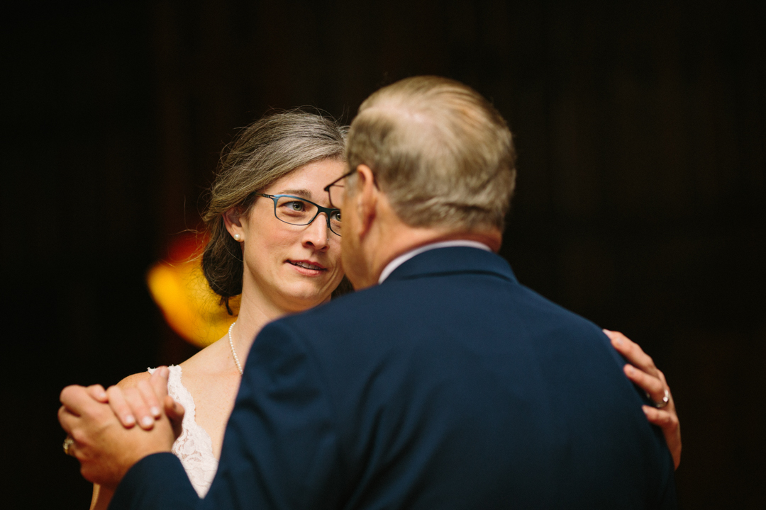 Heather looking sweetly into fathers eyes as they dance