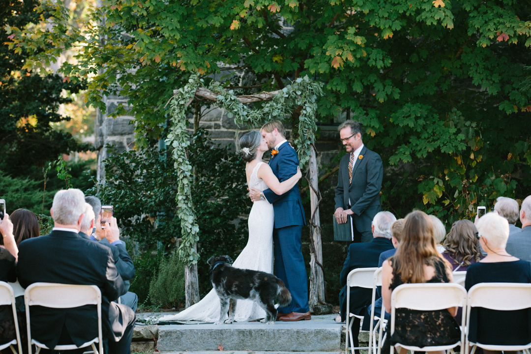 The wedding couple have their first kiss as husband and wife