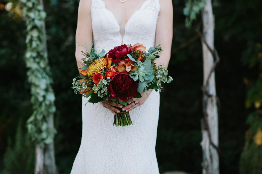 Beautiful bouquet being held by bride with picture only covering her torso
