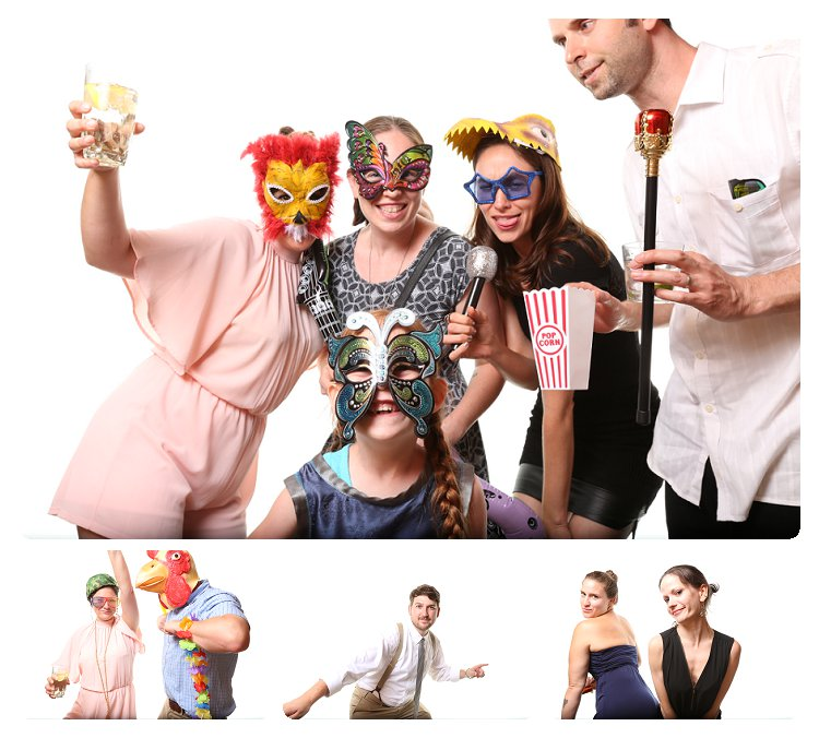 People having fun in the photo booth at wedding. All are dressed up and wearing props