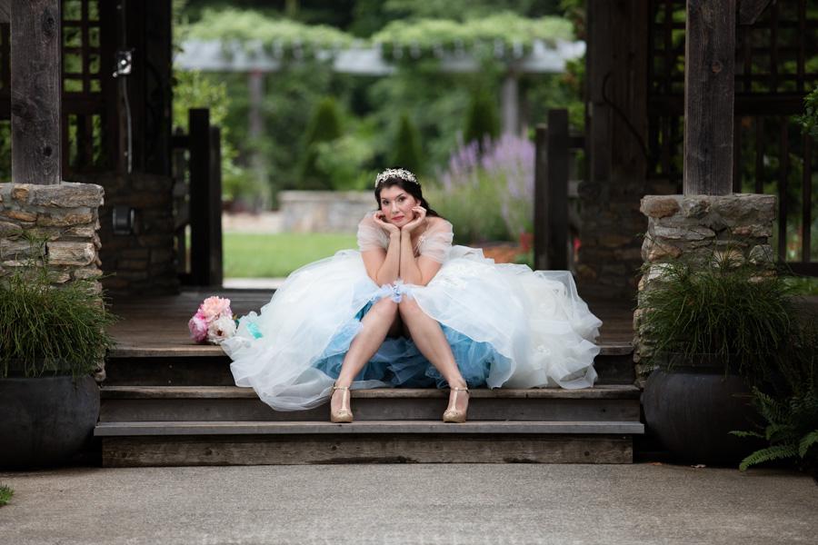 The North Carolina Arboretum Engagement Photo location. Girl dressed as princess sitting on stairs