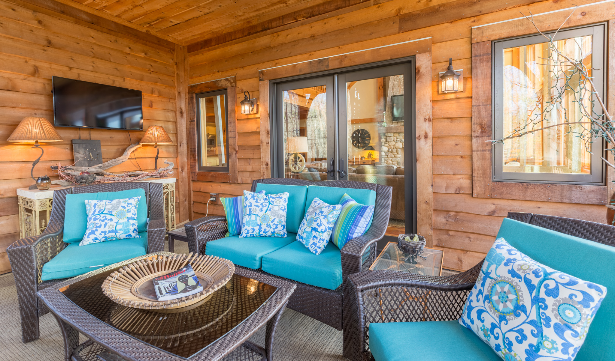 Exterior enclosed porch of cabin on lake James for realtor