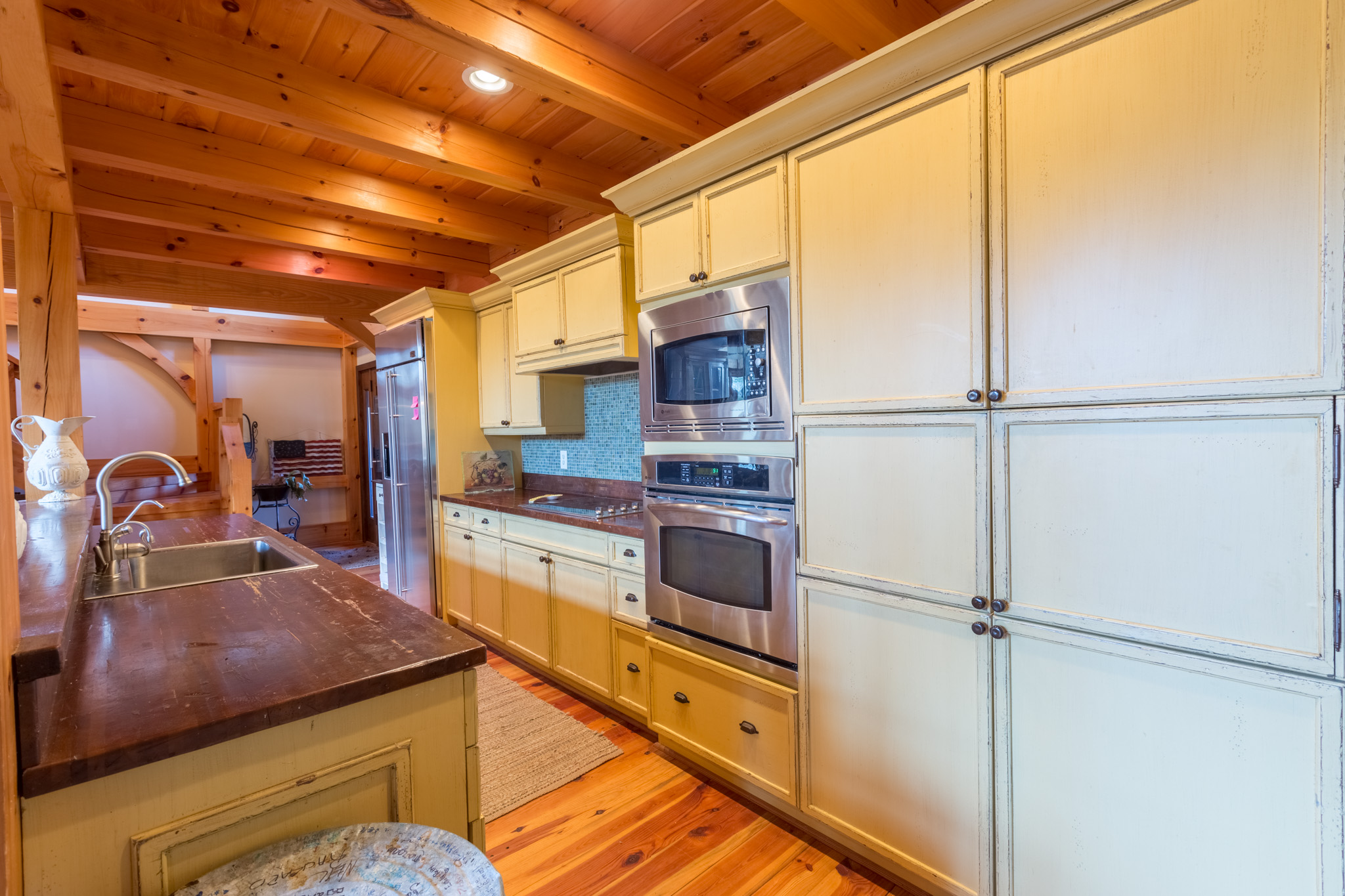 View of French country kitchen at cabin on Lake James Real estate