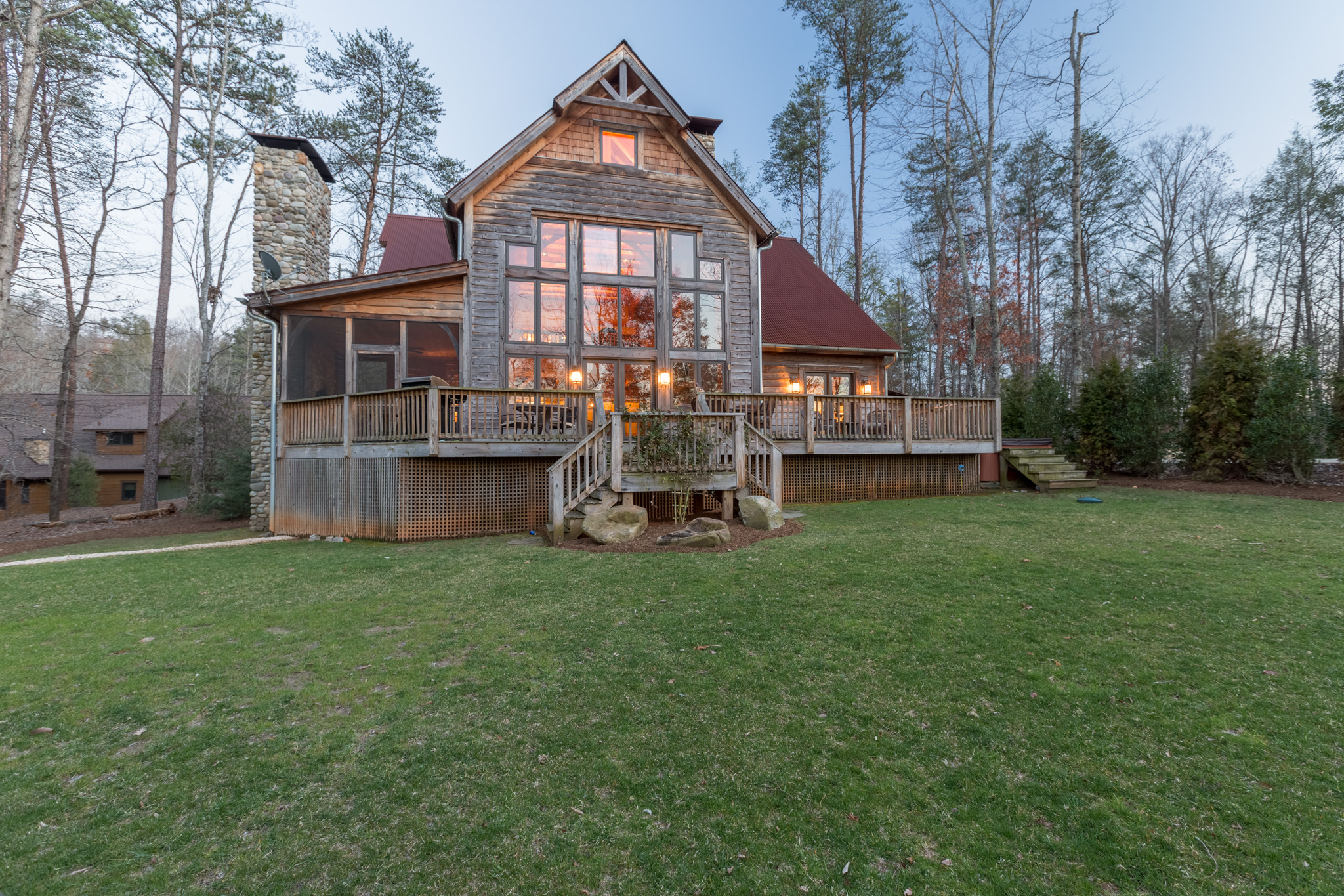 Real Estate Photography Nebo North Carolina - Night shot of cabin glowing next to Lake James