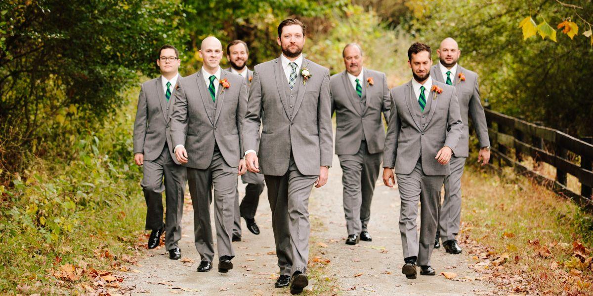 Asheville Wedding Photographer - Groom walking down the road in Asheville
