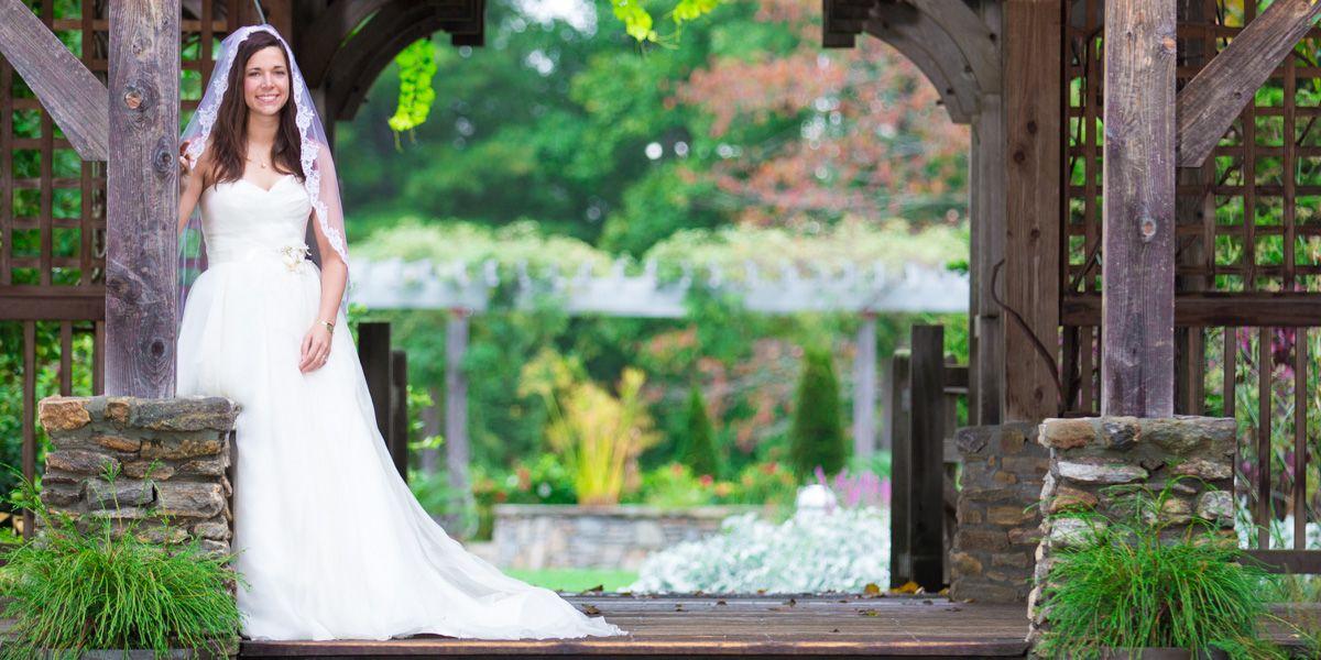North Carolina Arboretum Wedding Photographer - Bride standing in gardens