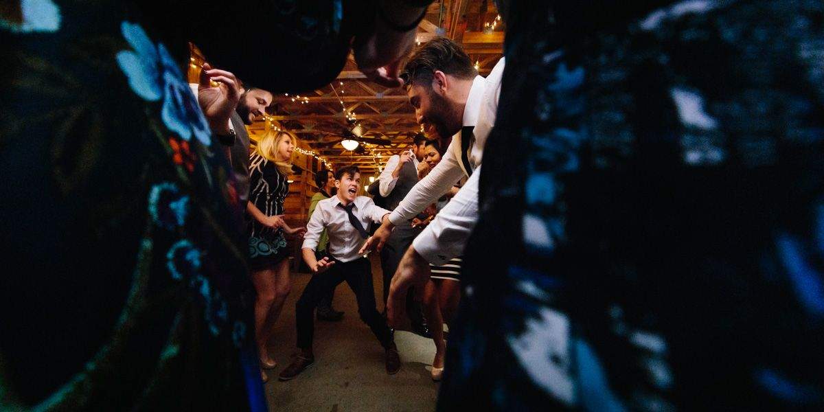 Asheville Wedding Photographer - Guest Dancing and having a fabulous time, shot with fisheye lens in a barn