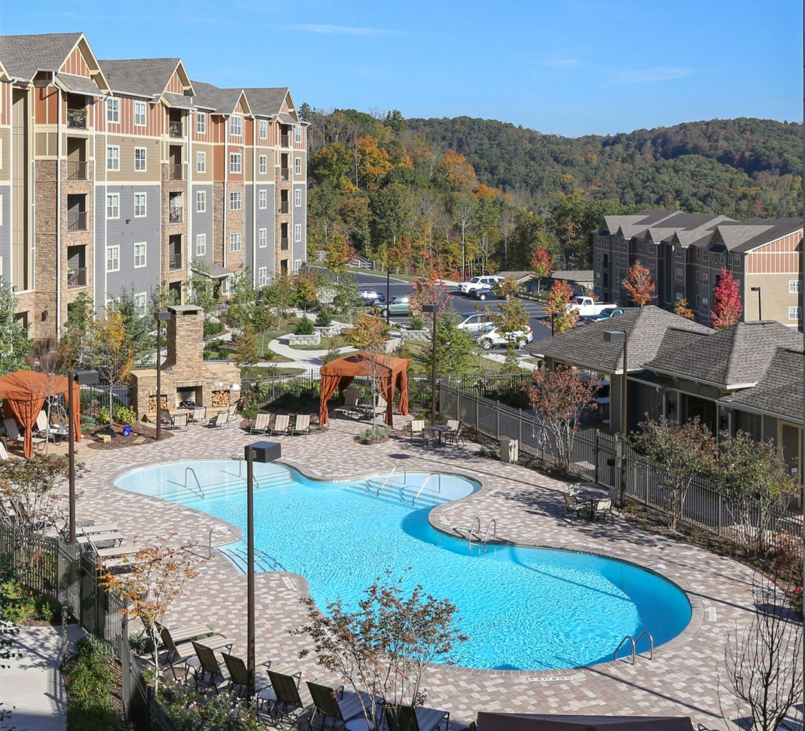 Commercial photography of The Aventine apartments in Asheville, NC. View shooting down on the pool looking out over the blue ridge mountains.
