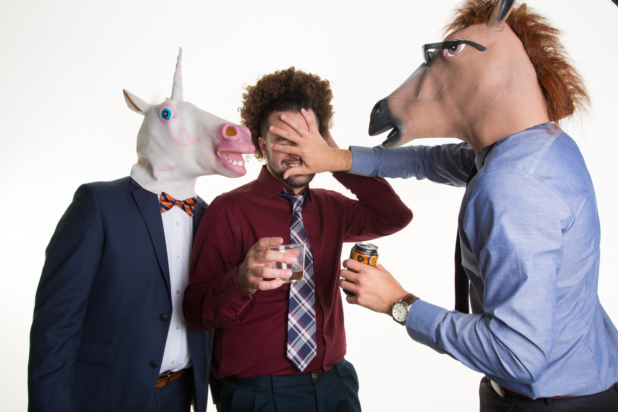 3 wedding guest in the4K Photo Booth, one wearing a horse head mask and another a unicorn mask.