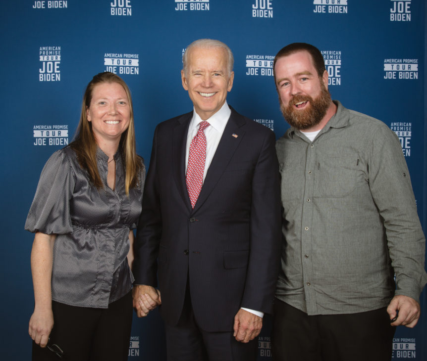 Will Thomas and Julie Thomas from Forge Mountain Photography standing in a photo with Joe Biden on the American Promise tour. This photo was taken at the end of the event after we were done photographing.