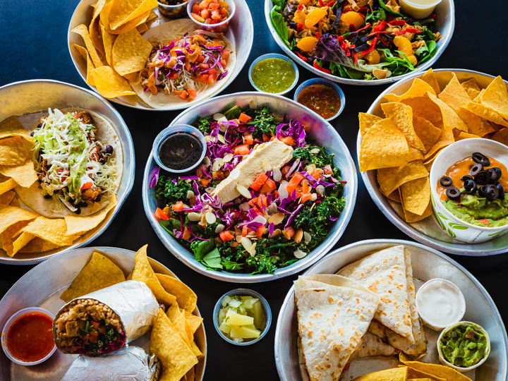 Mix of different dishes of food served at Neo Burrito